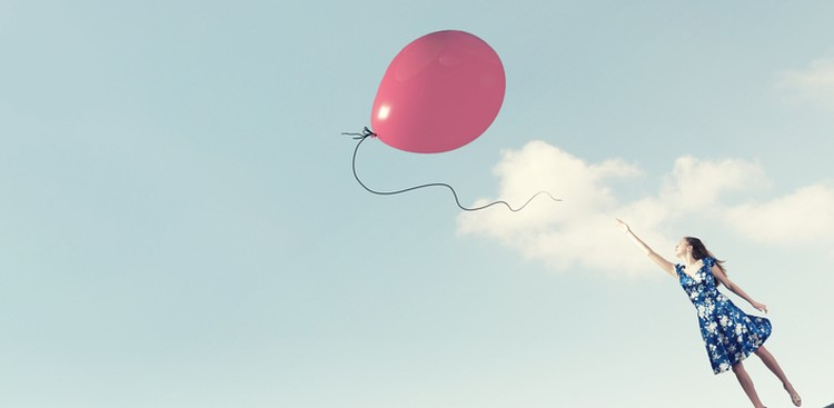 woman reaching for balloon