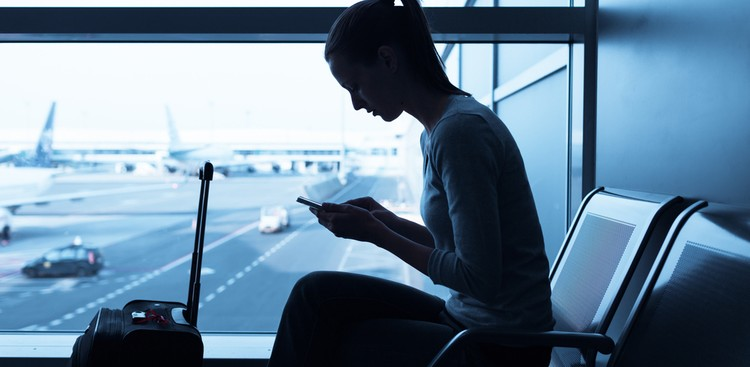 woman on phone at the airport