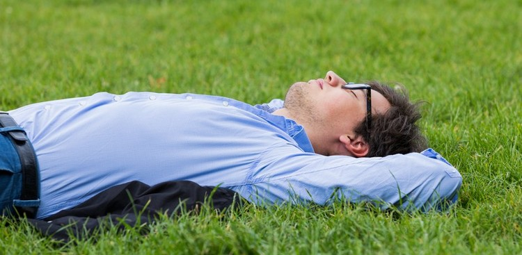 Man laying in the grass
