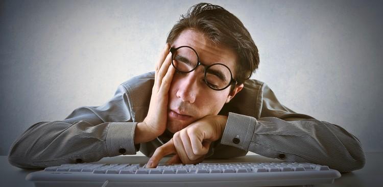 Man falling asleep on desk