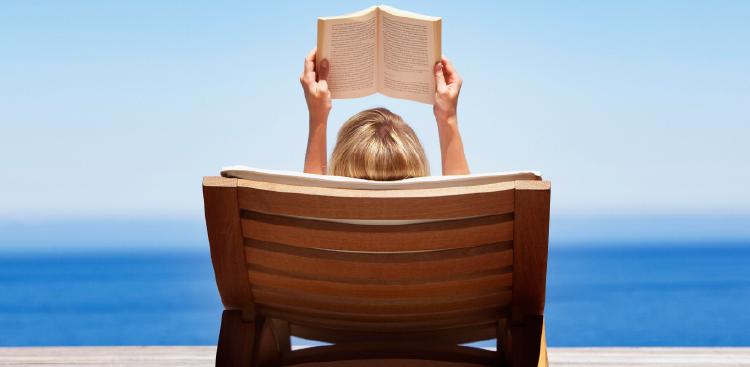 Woman reading on beach