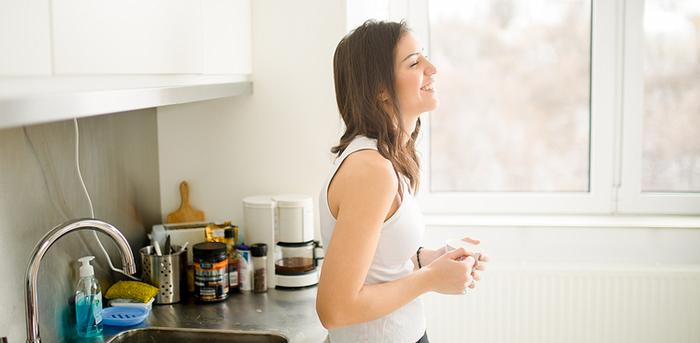 woman starting her day off in a good mood