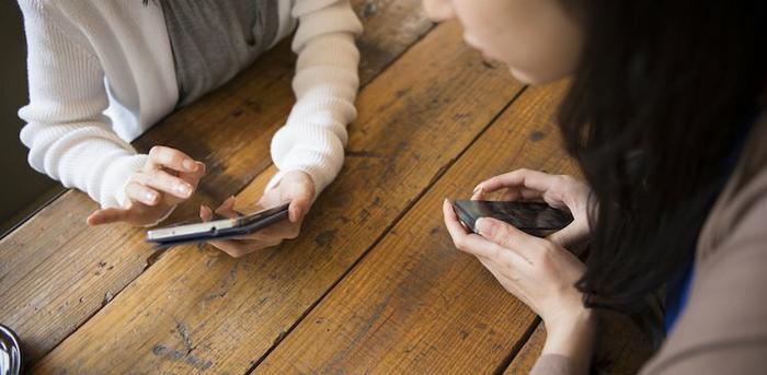people looking at phones