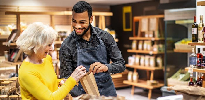 salesperson assisting customer in small store