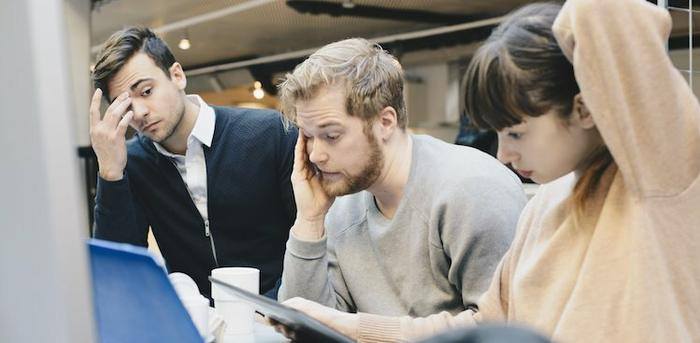 people stressed in a meeting