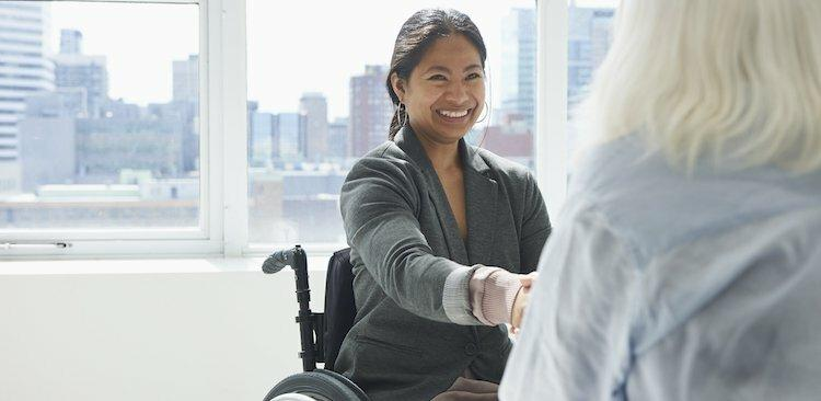 person with a disability shaking hands with a colleague