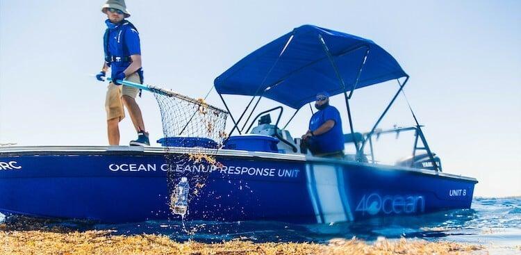 4Ocean employees cleaning up plastic in the ocean