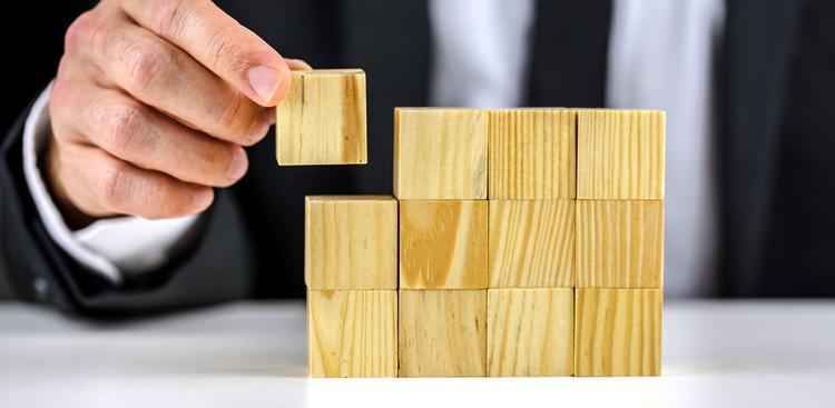 man stacking blocks