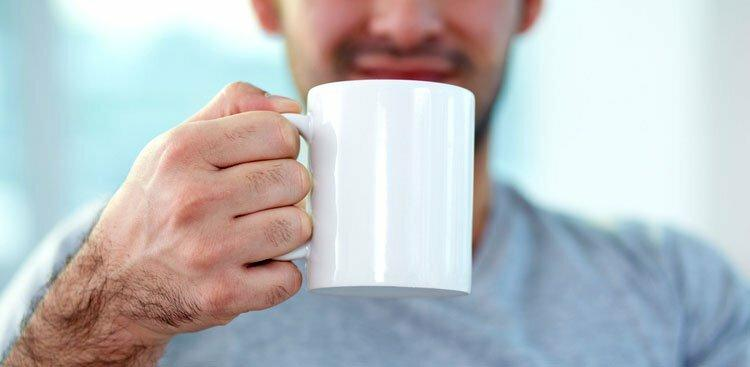 person drinking out of mug