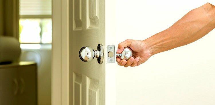 person opening door