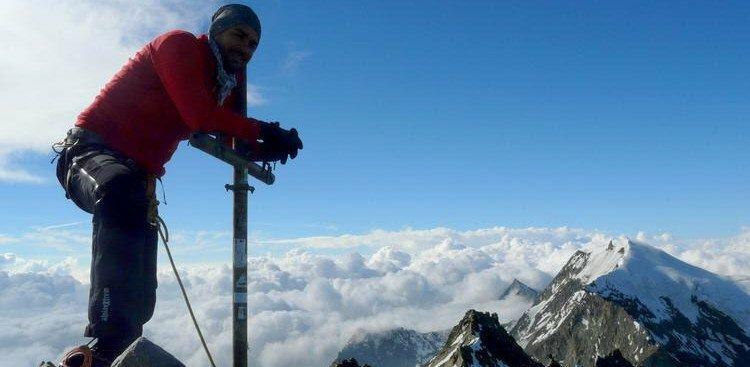 Photo of man climbing a mountain