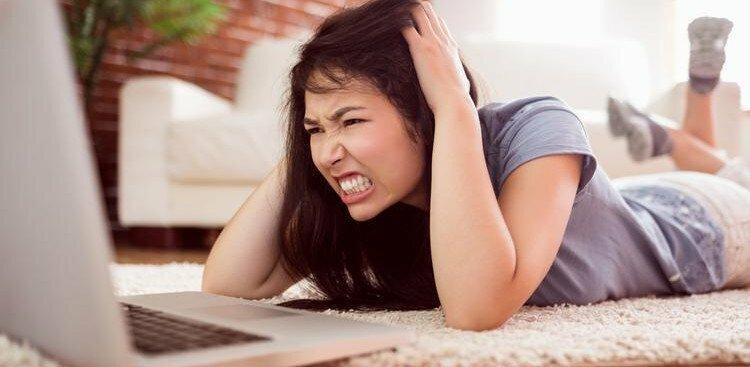 angry woman on computer