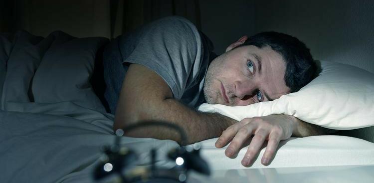man having trouble sleeping