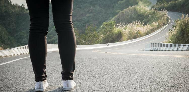 person standing in road