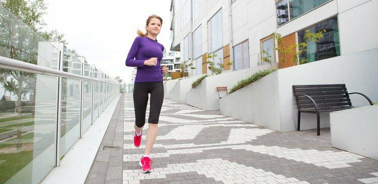 woman running outside office