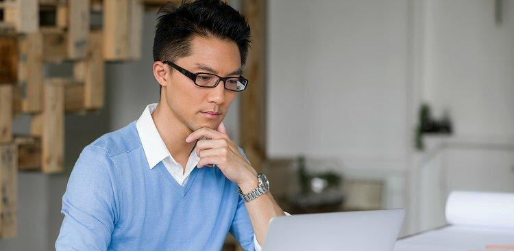 man having a difficult time at work