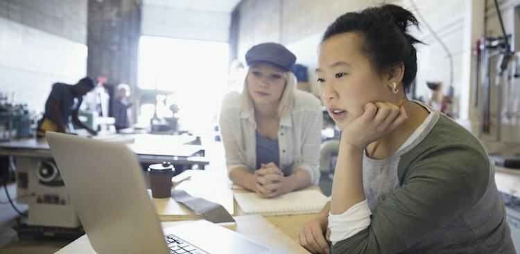 photo of girl on computer by Getty Images