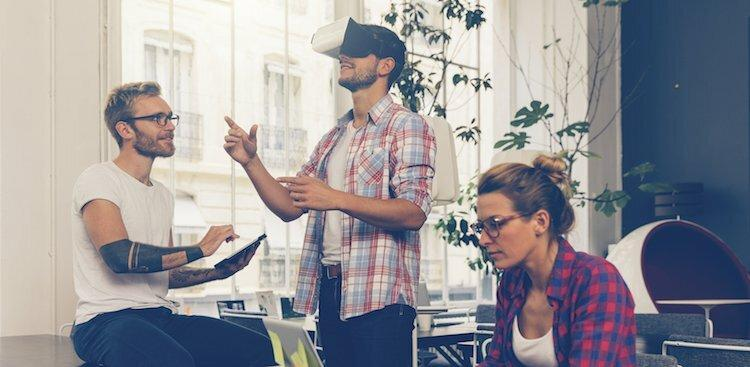 people using virtual reality headset in an office