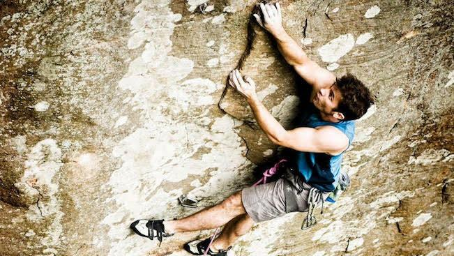 Jeremy Collins rock climbing