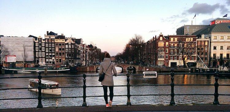 photo of girl overlooking canal