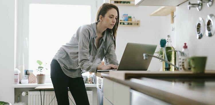 person on laptop in kitchen