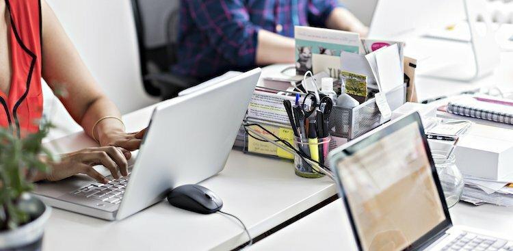 people on laptops in modern office