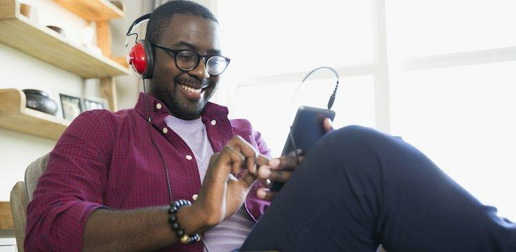person listening to podcasts courtesy Hero Images/Getty Images