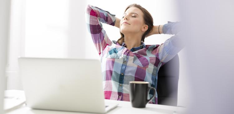 person relaxing at desk