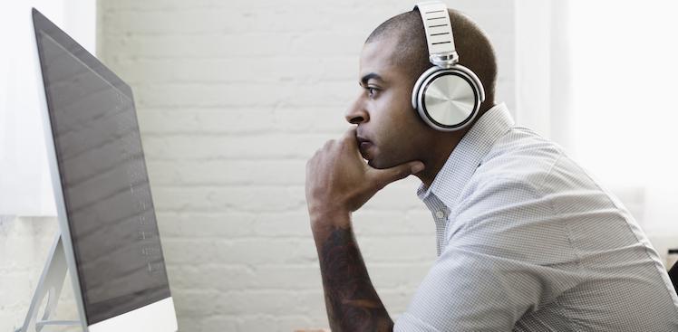 man listening to music at work