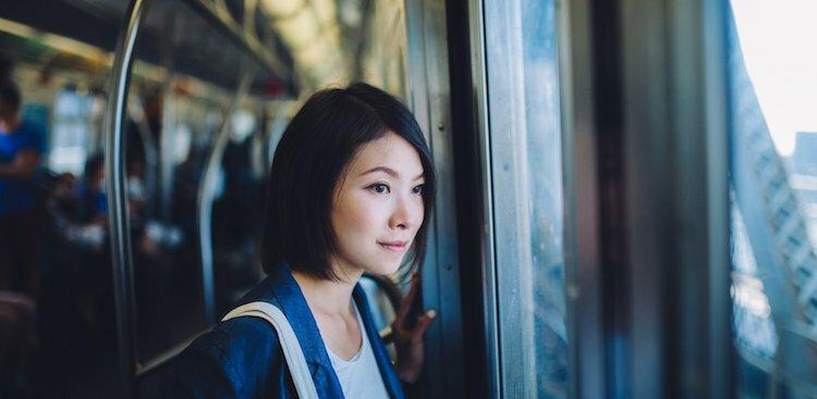 female looking out of window on subway
