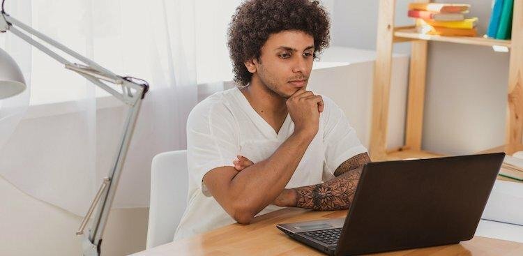 person thinking on computer