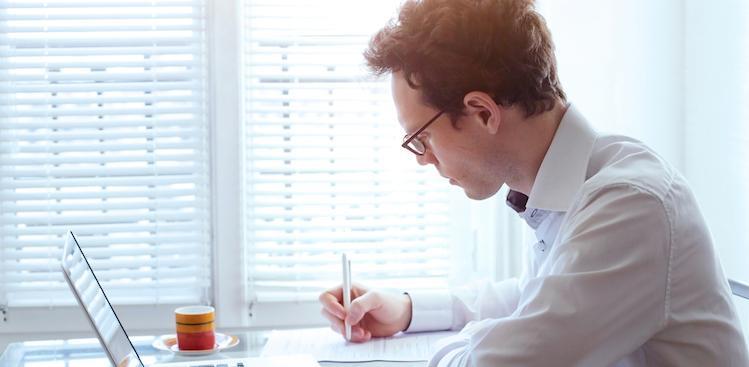 man working on resume