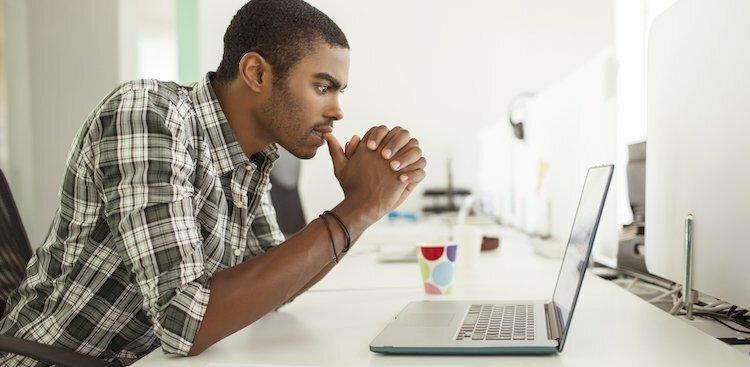 photo of man on laptop