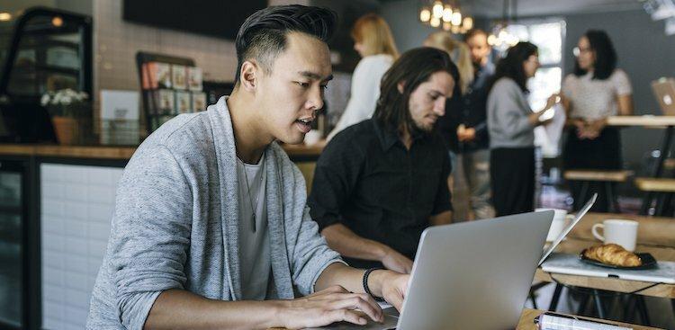 Photo of man on computer