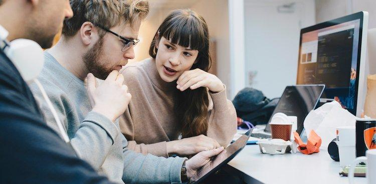 woman working with men