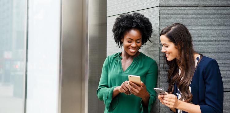 coworkers looking at their smartphones