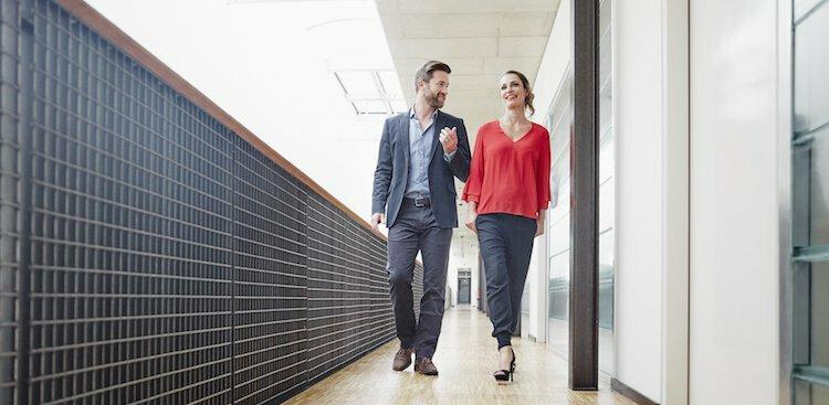 two co-workers walking