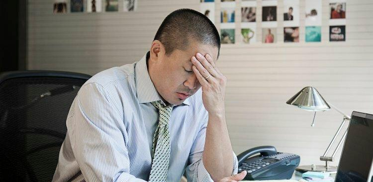 person stressed out at desk