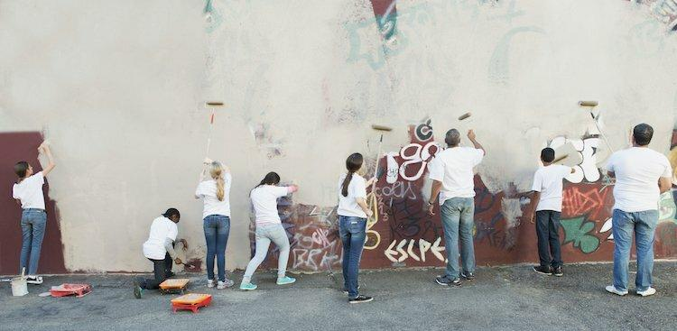 people painting wall