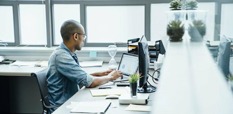 person on computer at work