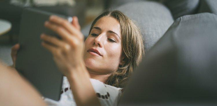 person reading on tablet