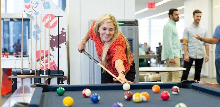 BounceX employee playing pool