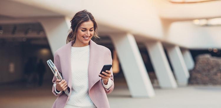 happy person checking smartphone