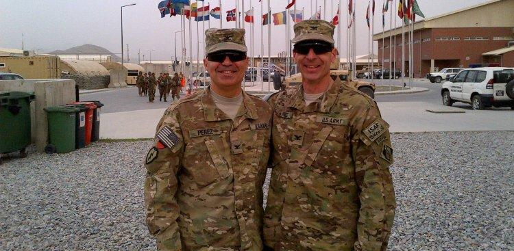 Carlos Perez (left) with a fellow service member