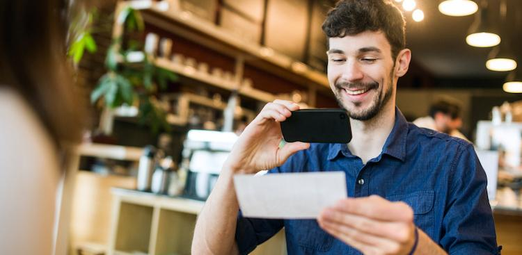 person taking a picture of their paycheck