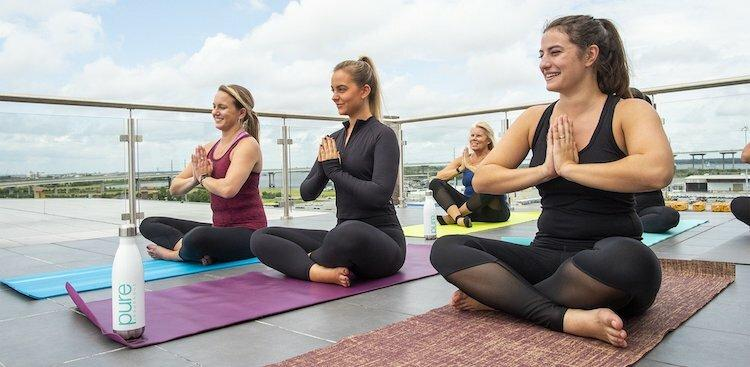 PURE Insurance employees participating in a yoga class