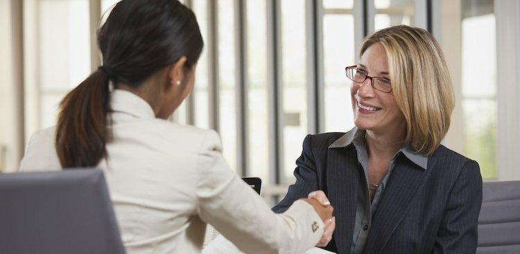 older job seeker shaking interviewer's hand