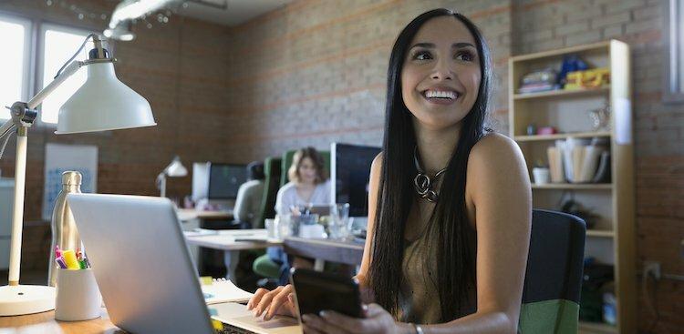 person confident at desk