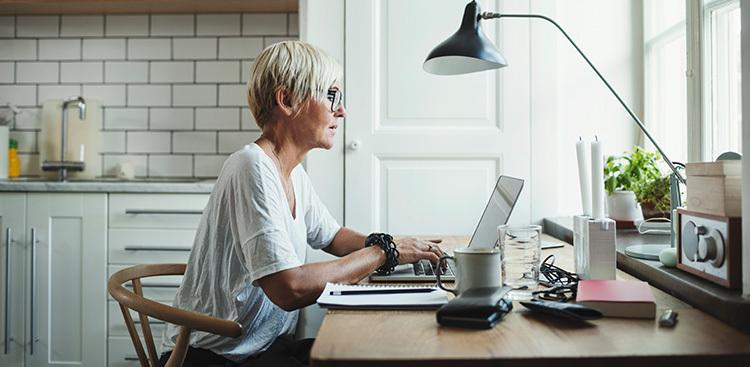 person using laptop at home office