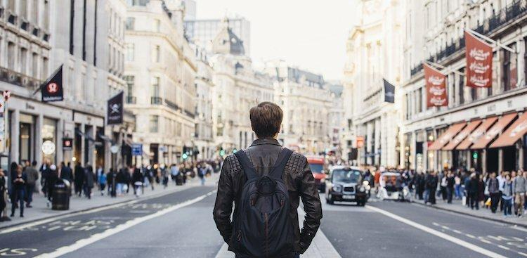 person walking down the street in London